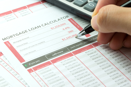 sheet: Mortgage loan balance sheet with hand hold a pen Stock Photo