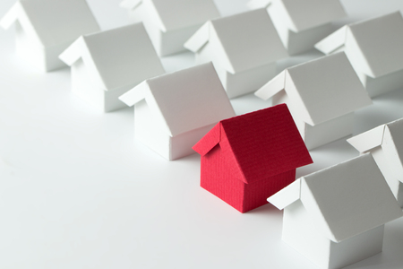 Red house in among white houses for real estate property industry Stockfoto