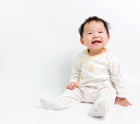 asian boy: Portrait of Asian baby girl sitting over white background