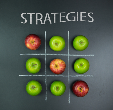 planning strategy: Strategies concept using apples in tic tac toe game
