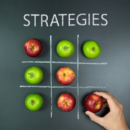 toe: Strategies concept with playing tic tac toe game using apples