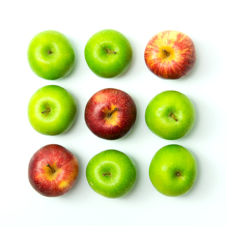 tic tac toe: Tic tac toe game using apples on white background Stock Photo