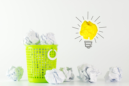 Concept of idea with yellow crumpled paper light bulb Stock Photo