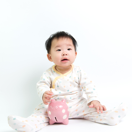 coinbank: Portrait of Asian baby with piggy bank Stock Photo