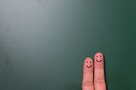 dark green background: Happy finger couple on dark green background with copy space