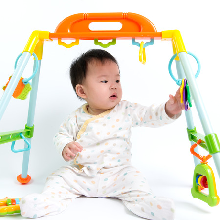 Asian baby girl playing over white background