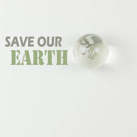 global environment: Save our earth wordings with glass globe at the side Stock Photo