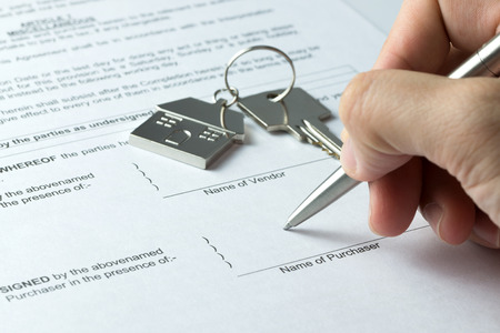purchaser: Man signing sale and purchase agreement at purchaser column