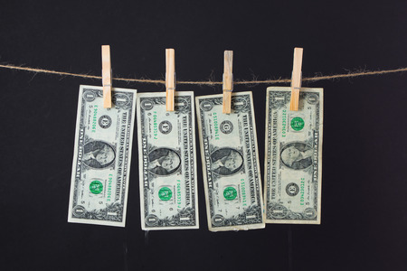 fraudulent: US dollar banknotes hanging on rope for money laundering conept