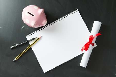 blank note: Blank note book with piggy bank, certificate, ball pen and pencil