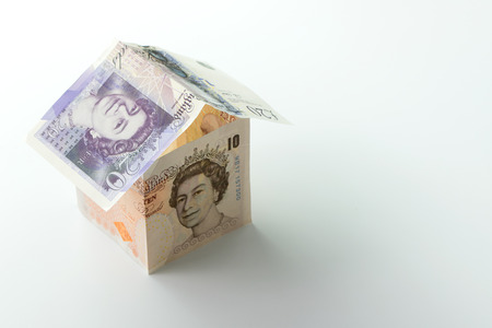 House made of pound banknotes with copy space