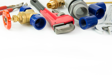 Various plumbing tools and materials on white background