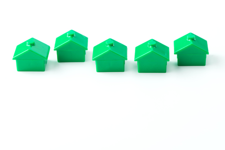 real estate industry: Row of green model houses for real estate industry concept