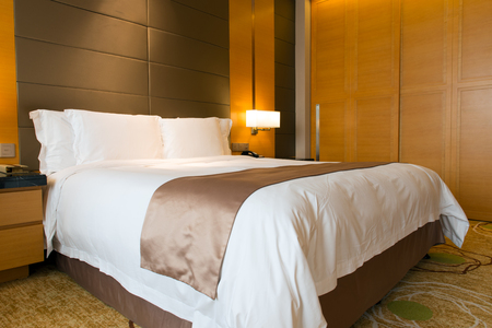 Interior of hotel bedroom with double size bed