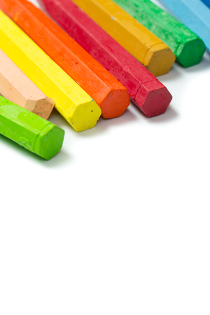 Row of colorful crayon isolated on white background
