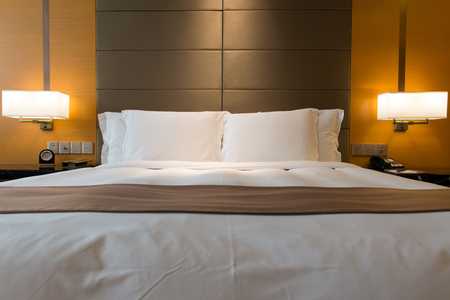 lamp light: Interior of hotel bedroom with double size bed