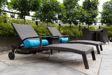 Two deck chairs with cushion at resort pool