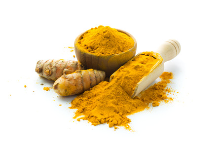 Fresh turmeric roots and turmeric powder over white background