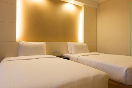 lodgings: Interior of twin bed in hotel bedroom