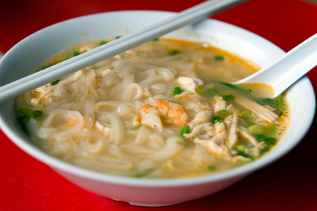 Close up of Ipoh Hor Fun, Chinese rice noodle soup with shredded chicken Stock Photo
