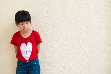 Portrait of Asian child look aside with face full of question