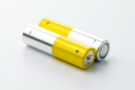 Two yellow AA size batteries isolated on white backgraound Imagens