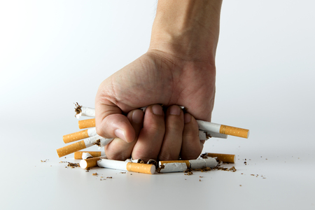 renounce: Fist crashing cigarettes for quit smoking concept