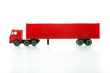 Red semi toy truck  isolated over white background