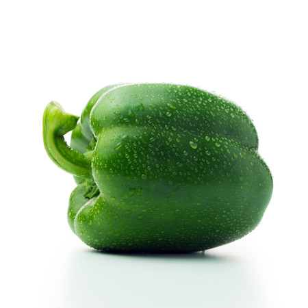 Fresh green bell pepper with water droplets isolated on white background