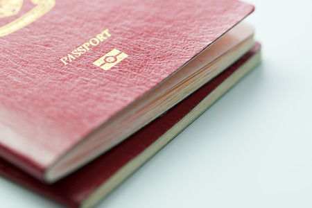 Close up of Malaysia passport with ID chip over white background Stock Photo - 85436878