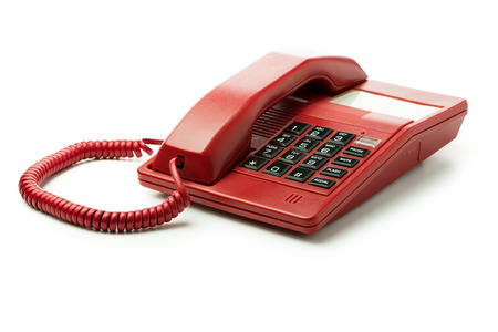 Red desk phone isolated on white background