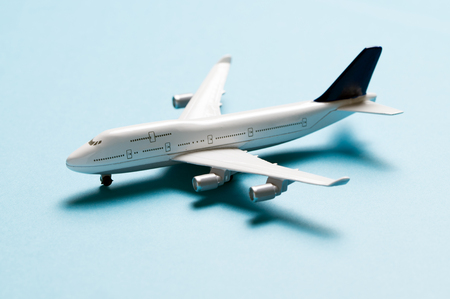 Close up of miniature airplane on blue background