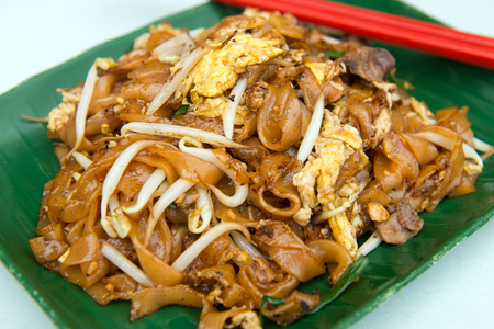 Close up of fried flat noodle, char kuey teow which is a famous hawker dish in Penang, Malaysia 스톡 콘텐츠