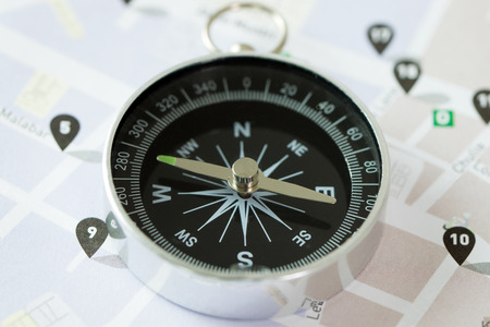 Compass on a city map for navigation or direction concept