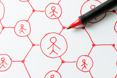 Social media network or people communication diagram drawn on paper using red color pen