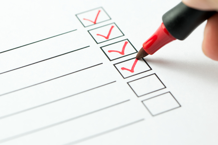 Checklist marked red with a red pen Archivio Fotografico