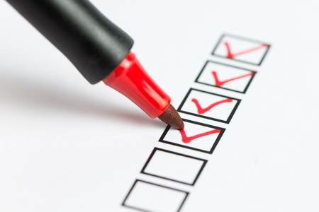 Checklist marked red with a red pen 免版税图像
