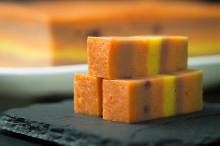 Orange mixed with taro flavor Sarawak layer cake