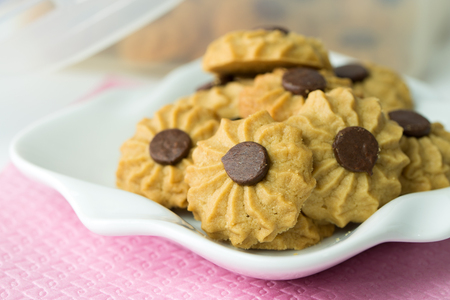 Coffee butter chocolate chip cookie served on white plate