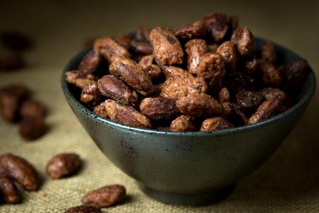 Sugar, honey or caramel coated roast almond in bowl