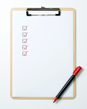 Checklist on clipboard with a red pen isolated on white background