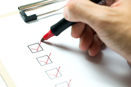 Checklist marked red with a red pen Standard-Bild