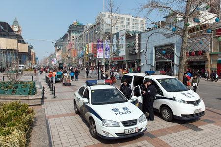 Beijing, CHINA - 23 MAR, 2018: Two police car at Wangfujing street Beijing, China