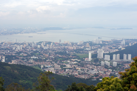 Panoramic view of Penang town in Malaysia with Penang bridge from the top of Penang Hill in day light. Stock Photo