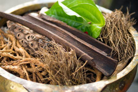 Traditional Indonesian or Thailand spices used in spa massage treatment.