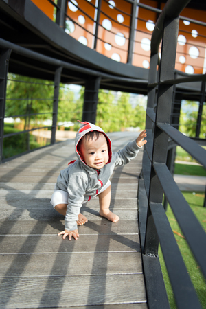 Portrait of little Asian baby boy at outdoor park