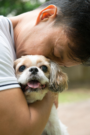 Asian young man with his pet Shih Tzu puppy dog outdoor Reklamní fotografie - 105521763