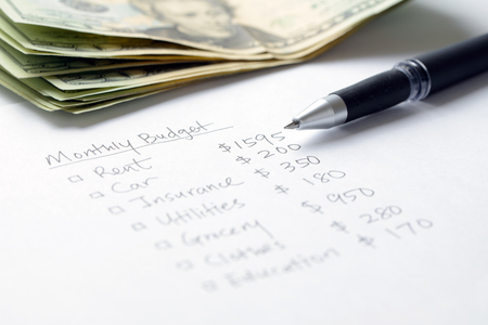 Monthly budget planning sheet with pen and US dollars Stok Fotoğraf