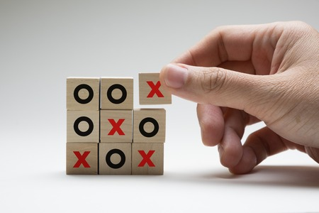 Business or marketing strategy planning concept using wooden cubes tic tac toe board game Imagens