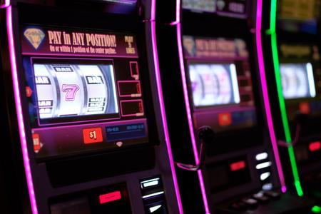 Close up of gaming slot machines in casino Stock Photo